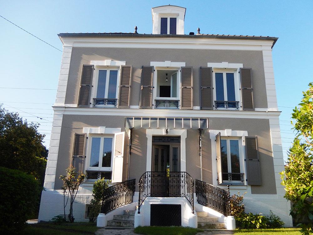 Réintégration des façades d'une demeure 1870 dans l'air du temps après